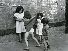 Untitled, New York (boy lifting girls skirt)