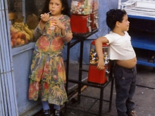 Untitled, New York (boy and girl leaning on candy machine), 1971