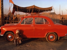 Pilgrim and Ambassador car, Kumbh Mela, Prayag, Uttar Pradesh, 1977